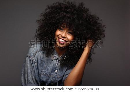 Confuso mulher jovem cabelos cacheados em pé isolado rosa Foto stock © deandrobot