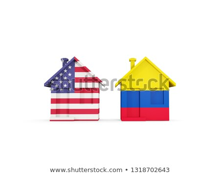 Two houses with flags of United States and colombia Stock photo © MikhailMishchenko