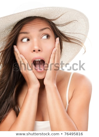 Portrait of a shocked asian woman in summer hat Stock photo © deandrobot