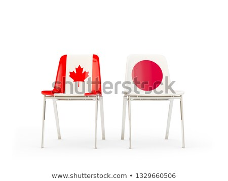 two chairs with flags of canada and japan stock photo © mikhailmishchenko