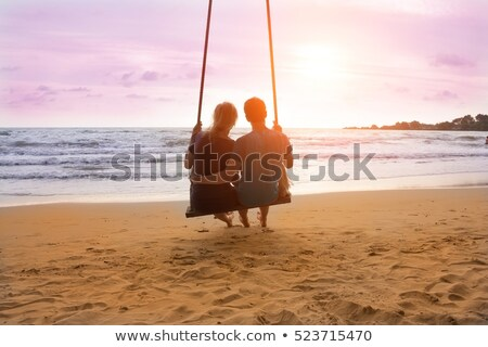 Foto d'archivio: Young Relaxed Couple Looking At The Calm Ocean