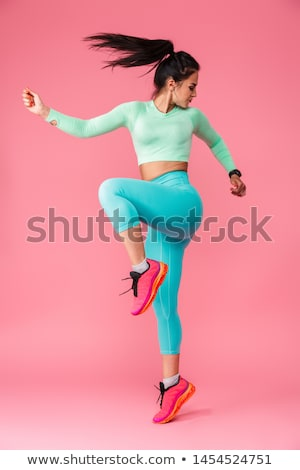 sports woman make sport exercises isolated indoors stock photo © deandrobot