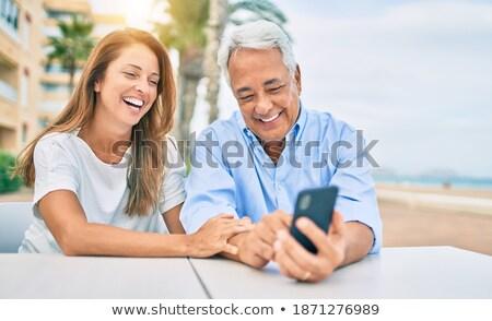 Gelukkig gezin smartphone cafe terras familie generatie Stockfoto © dolgachov