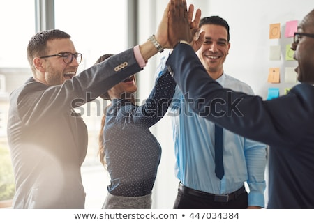 businesspeople giving high five in office stock photo © andreypopov
