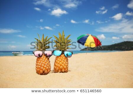 Beach vacation concept pink sand parasol  Stock photo © lunamarina