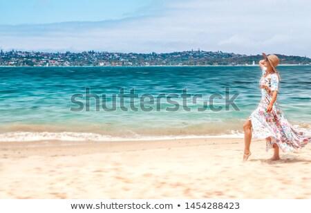 Woman in flowing dress on beach in Sydney Australia Stock photo © lovleah