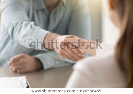 Handshake of young successful business partners after making deal or negotiating Stock photo © pressmaster