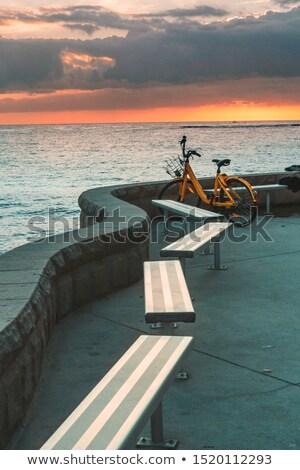 Vélo vide banc océan sunrise jaune Photo stock © lovleah