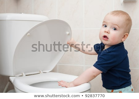 Toddler in bathroom look at the toilet Stock photo © Lopolo