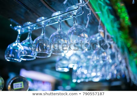 Stock photo: Clean Washed And Polished Glasses Hanging Over A Bar Rack