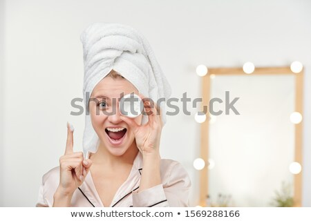 Fresh and clean young beautiful woman keeping forefinger by her mouth Stock photo © pressmaster