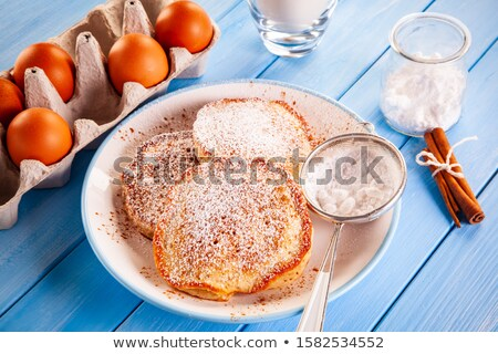 Sweet pancakes and ingredients on timber background Stock photo © JacekChabraszewski