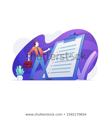 Positive businessman reading business rules and policies. Stock photo © sgursozlu