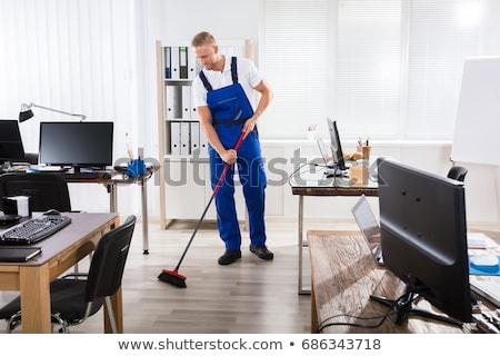Felice maschio lavoratore ginestra pulizia ufficio Foto d'archivio © AndreyPopov