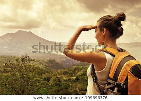 Nő utazó néz vulkán Indonézia égbolt Stock fotó © galitskaya