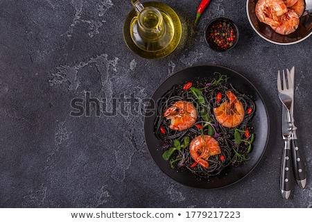 Fekete spagetti tészta felső kilátás búza Stock fotó © karandaev