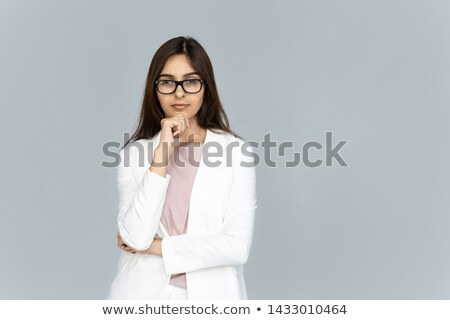 Headshot of serious self confident businesswoman wears optical glasses, dressed in striped shirt, lo Stock photo © vkstudio