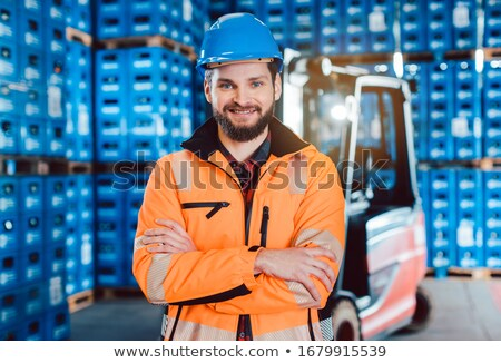 Worker in a forwarding company with his forklift Stock photo © Kzenon