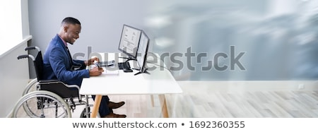 African Accountant Working On Tax Invoice Stock photo © AndreyPopov