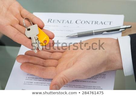 zakenman · kantoorgebouw · verkoop · teken · knap · vacant - stockfoto © cienpies