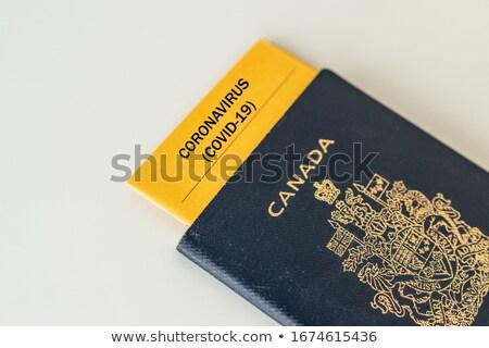 Coronavirus travel ban Canada passport with health certificate test proof of Corona virus free passe Stock photo © Maridav