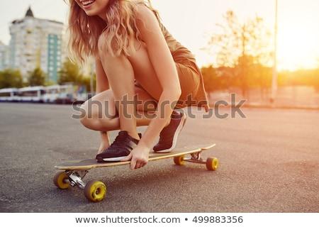 Genç kız kaykay şehir sokak yaz doğa sporları insanlar Stok fotoğraf © dolgachov