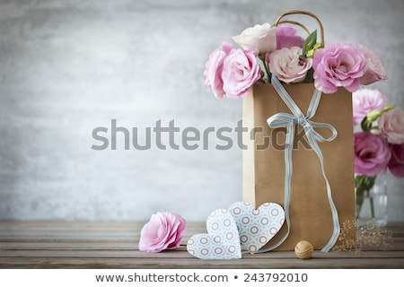 Photo stock: Grunge Paper With Bunch Of Flower On The Wooden Background