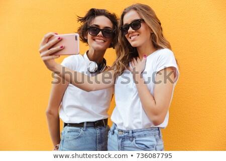 Teenage female girl isolated against orange stock photo © mkm3