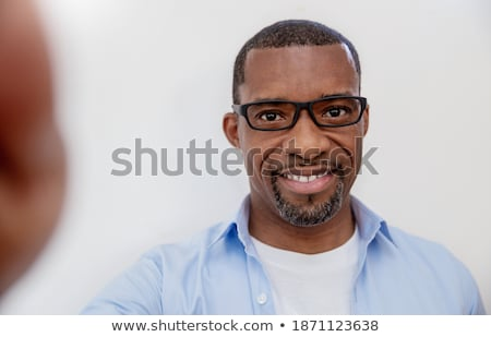 closeup portrait of a smart young businessman smiling and his co stock photo © hasloo