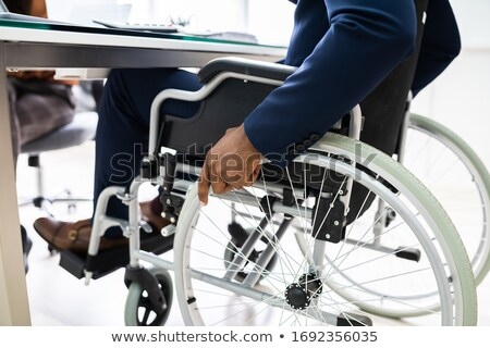 Man in wheelchair holding laptop Stock photo © photography33