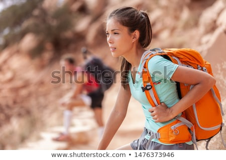 Woman carrying heavy travel bag stock photo © photography33