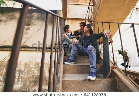 Teens gathered by stairs Stock photo © photography33