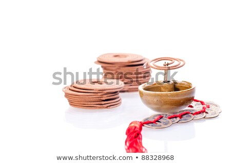 incense coil burning with old chinese coins stock photo © calvste