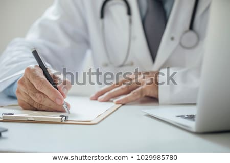 Doctor writing. Digital Hospital Stock photo © REDPIXEL