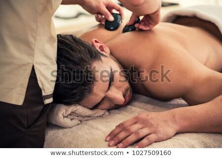 человека · расслабляющая · массаж · кровать · горячей · камней - Сток-фото © stockyimages
