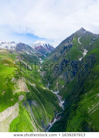 Alto montanas nubes cáucaso Georgia deporte Foto stock © BSANI