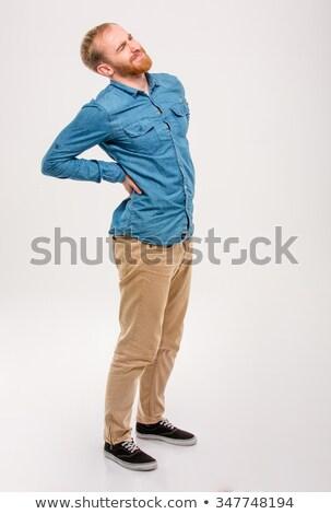 Full Length Portrait Man with Back Pain Stock photo © scheriton