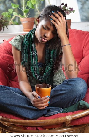Distraught woman sitting on chair Stock photo © sumners
