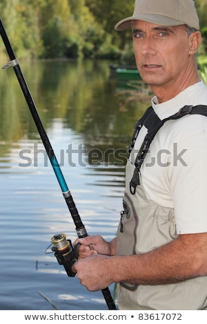 50 years old man fishing on the edge of a river stock photo © photography33