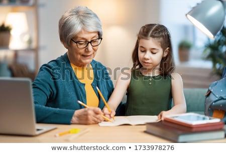 grand-mère · lecture · livre · peu · petite · fille · chambre - photo stock © photography33