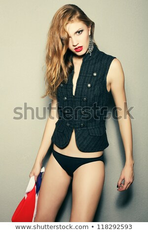 fashionable model with curly hair over the wooden background. da Stock photo © Augustino