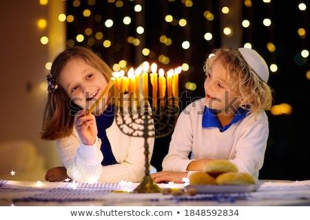 young boy with hanukkah menorah stock photo © lisafx