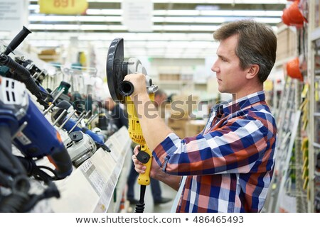 Man holding angle grinder in one hand Stock photo © photography33