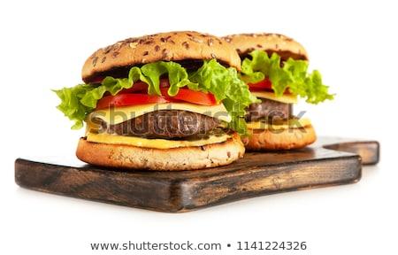 Cheeseburger mesa de madeira isolado branco comida carne Foto stock © moses