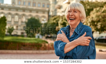 Senior woman with a banner. stock photo © Kurhan