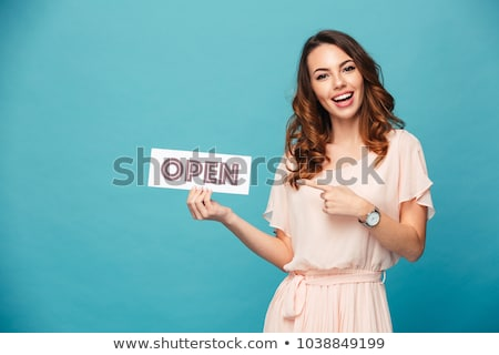Woman in fancy dress pointing at sign Stock photo © photography33