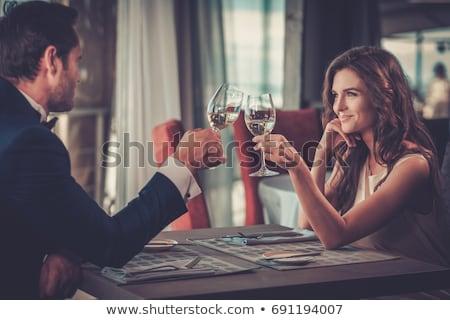 Stockfoto: Gelukkig · glimlachend · paar · restaurant · vieren · toast