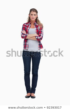 Portrait of an irritated woman with the arms crossed against a white background Stock photo © wavebreak_media