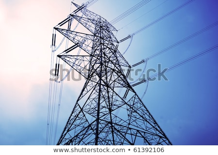 Electricity Pylons With Long Cable At Day Stok fotoğraf © cozyta