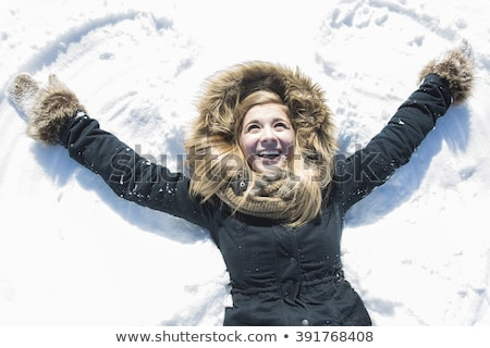 Blond woman laying in the snow Stock photo © photography33